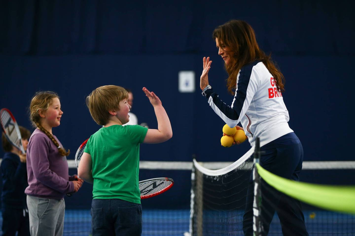 """BIRMINGHAM, ENGLAND - MARCH 05: Tennis for Kids with Annabel Croft during day two of the Davis Cup World Group first round tie between Great Britain and Japan at Barclaycard Arena on March 5, 2016 in Birmingham, England. (Photo by Jordan Mansfield/Getty Images for LTA)"""