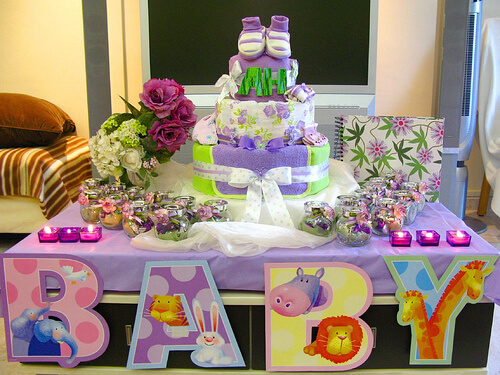 Baby Shower Decoration Ideas Candles Flowers Candies and Diapers Cake