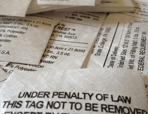 A photo of law labels for padded products regulatory requirements.