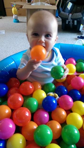Aiden-holding-balls-in-pit