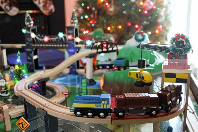 I decided to use our toddler's train table as part of our holiday decor. I had a ton of fun with this Christmas train decoration.