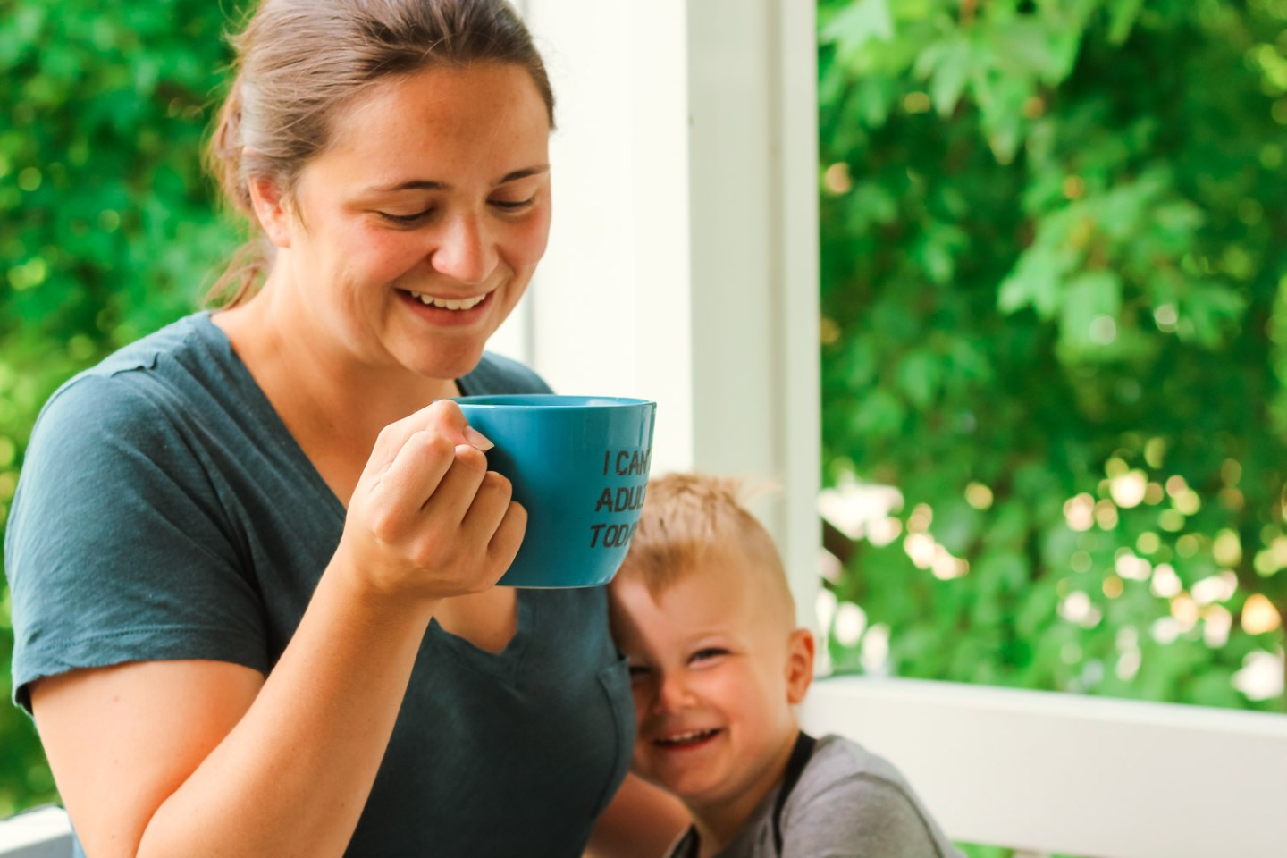 iced coffee ideas_Mom drinking coffee with smiling toddler