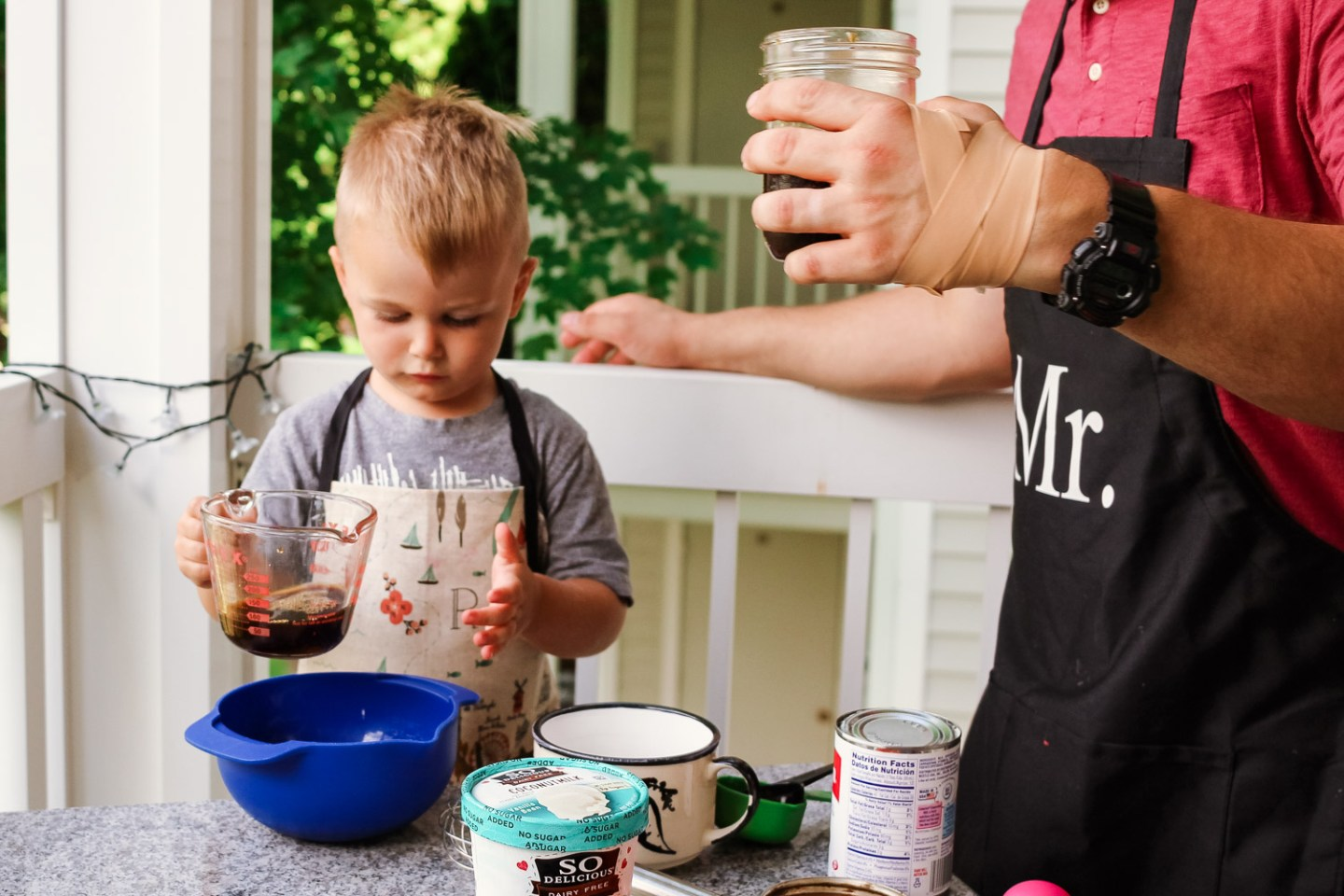 iced coffee ideas_Toddler holding measuring cup