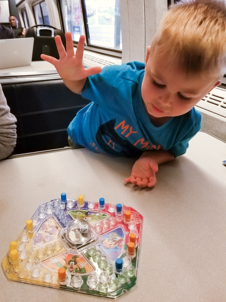 Train travel with a toddler_toddler playing trouble game