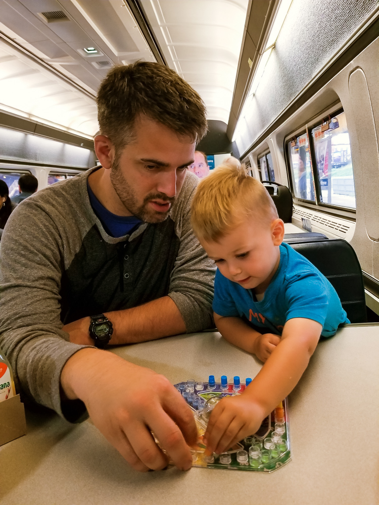 Train travel with a toddler_toddler playing trouble with dad