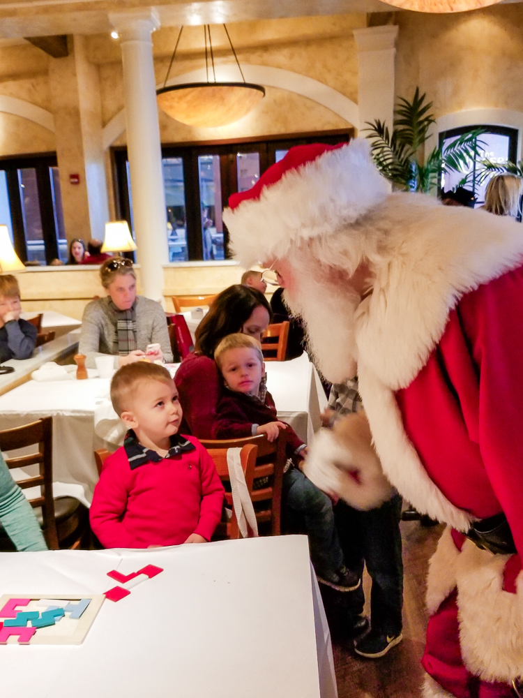 The Secret to a Cry-Free Santa Visit with a Toddler featured by top DC mommy blogger, Baby Castan on Board: Santa speaking to toddler