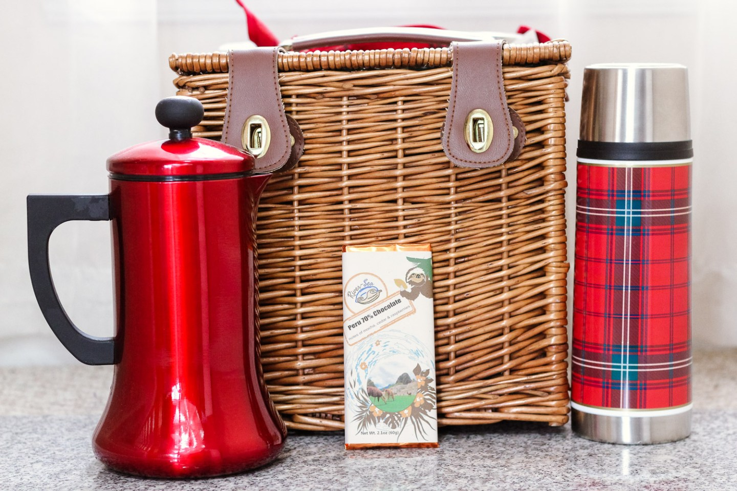 A Simple Valentines Date Idea featured by top US lifestyle blog, Baby Castan on Board: image of a picnic basked with hot chocolate essentials