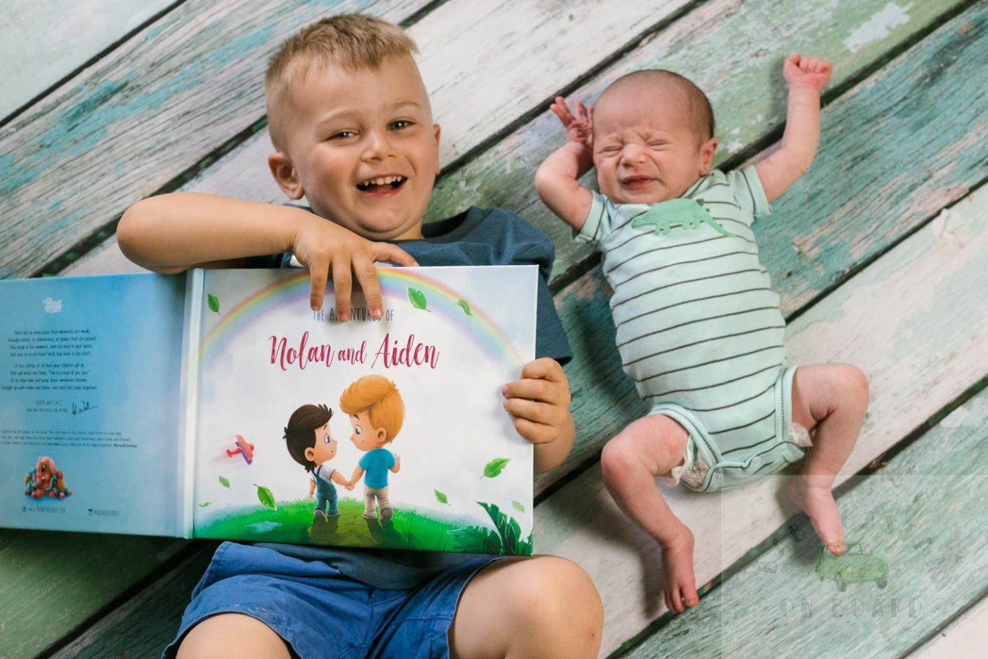 The Perfect Hospital Gift From Baby to Big Brother featured by top US mommy blog, Baby Castan on Board: image of a toddler holding a custom book with his baby brother