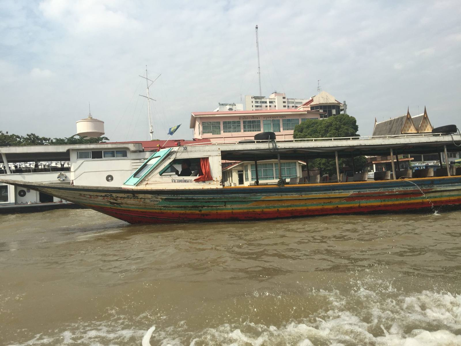express boat in bangkok thailand is lots of fun for young children, and you see so many wonderful sights, like temples and other boats whizzing past