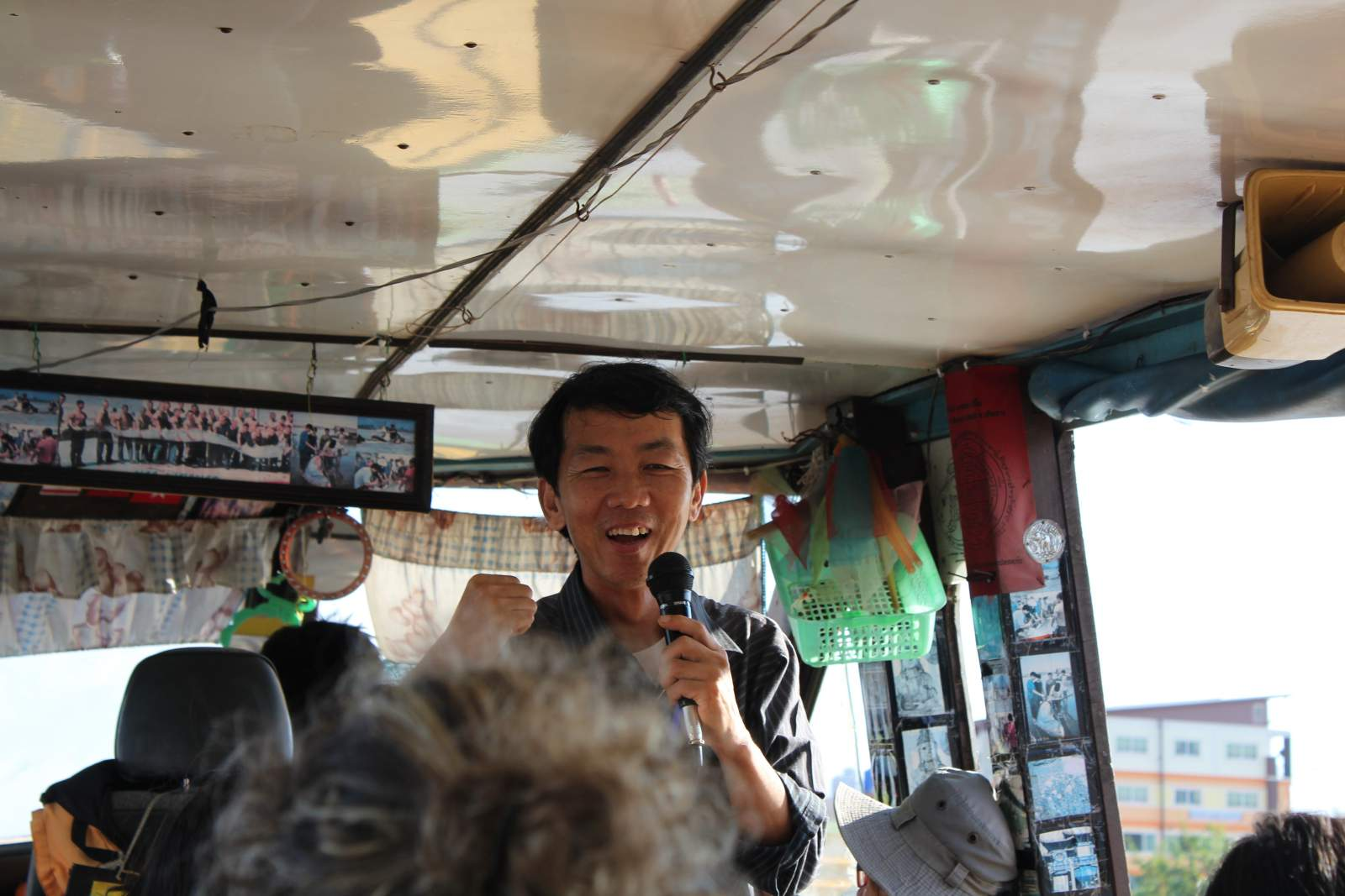 guide on the boat to laos from chiang rai thailand golden triangle