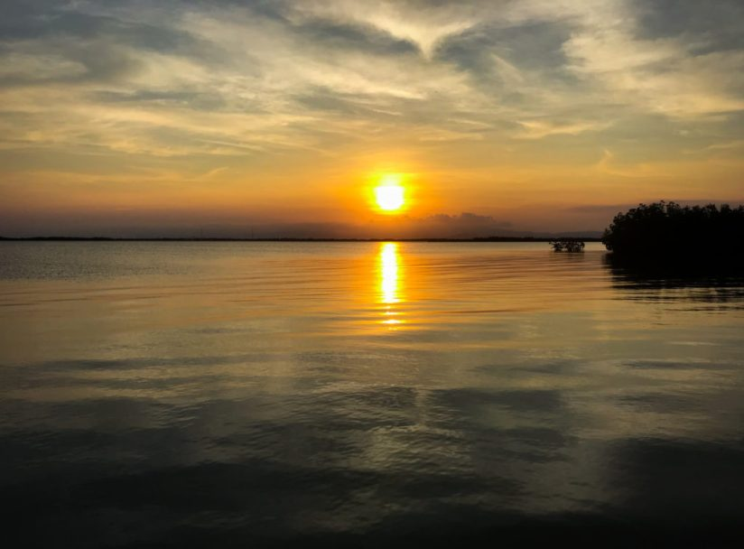 sunset over Placencia lagoon in Belize