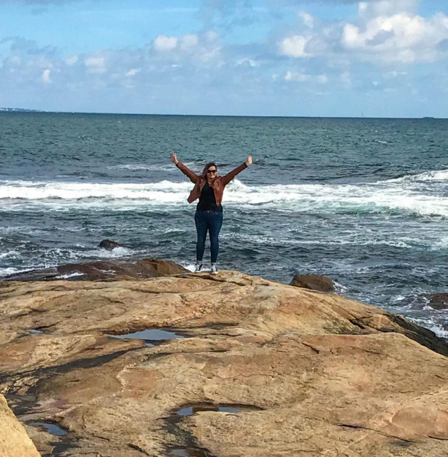 girl on rocks by the ocean