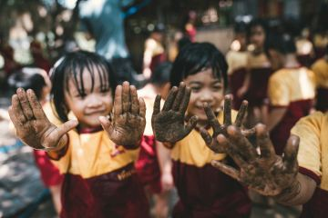 Children showing their dirty hands