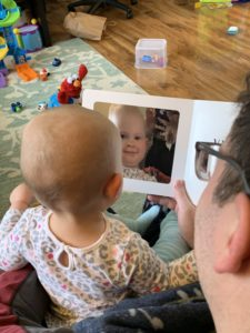 Marian reading A is for Awesome with her daddy