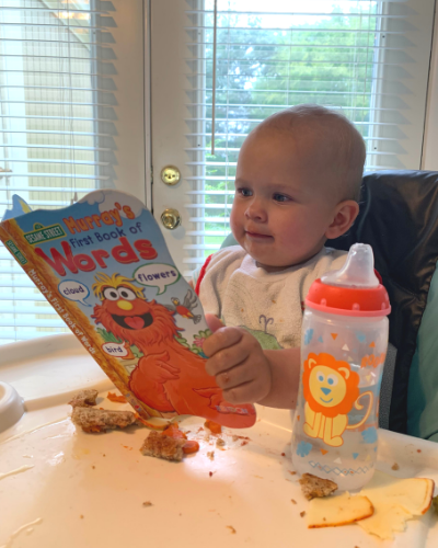 Marian reads Sesame Street over breakfast