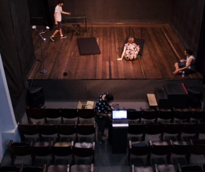 Actors on a stage theatre.