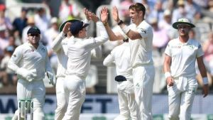Ireland test team celebrating after taking a wicket at the Lord's