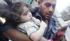 Child pulled from rubble in Syria