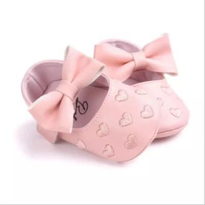 Zapatitos rosados corazones