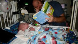 Daddy reading some bedtime lullabies before going to sleep.