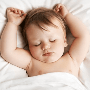 baby sleeping peacefully with white noise