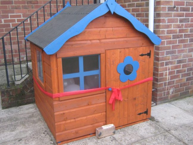 Children's wooden playhouse for the garden