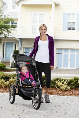 Mother with baby in jogging stroller