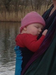 Sleeping baby in a hugabub wrap whilst out for a walk
