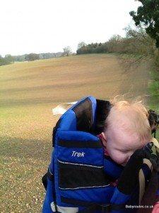 Sleepy baby in Kelty Kids rucksack