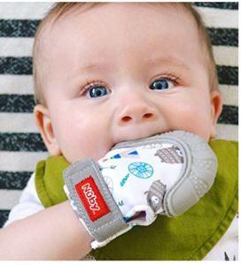 baby using teething glove