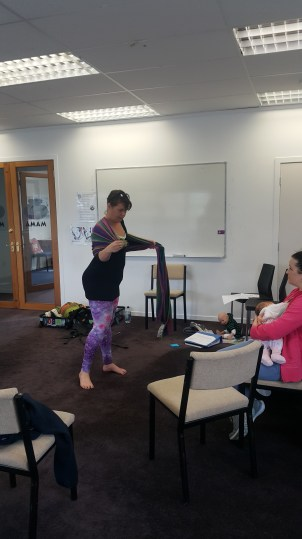 Demonstrating the ring sling in more detail while Steph settled baby Jessica