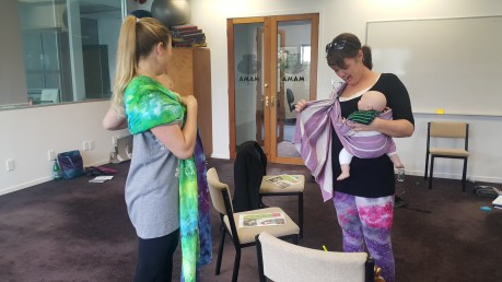 Talking about the importance of cupping your shoulder and spreading back passes to support babies weight