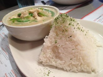 Green curry with chicken and a pyramid of rice.