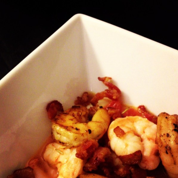 Shrimp and Grits in a tomato, rosemary, garlic sauce