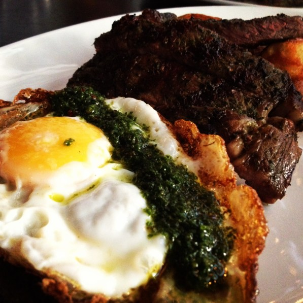 Ribeye, fried egg, potatoes, chimichurri sauce.