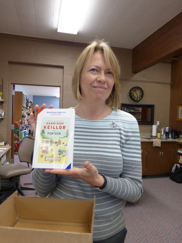 "Linda Friedow, librarian at Britt Public Library shows off  one of ""my"" books!"