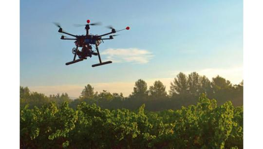 robot flying over crops