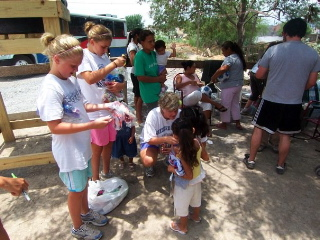 Casey and her friends distributing bows to girls at the Rio