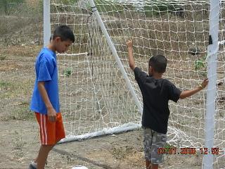 Two neighborhood boys admiring the new soccer net