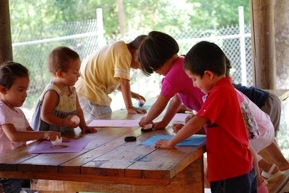 Children working on an art project during craft time