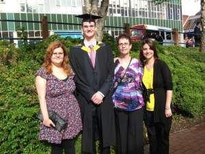Mykel Mason, Doctor of Chiropractic pictured with his family on graduation day after studying Chiropractic at the Welsh Institute of Chiropractic.
