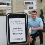 Image shows Sports Massage Therapist Oly Ody outside of Lushington Chiropractic in Eastbourne