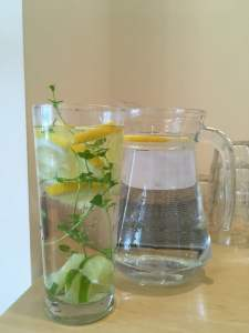 Infused Water - Image shows jug of water and glass of water infused with lemon, mint and cucumber to accompany the blog by Eastbourne Doctor of Chiropractic Victoria White