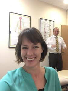 Images shows Dr Victoria White taking a selfie but with James Revell in the background