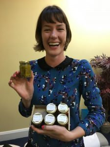 Image shows Chiropractor Dr Victoria White holding a box of 6 jars of yummy chutney.