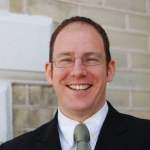 Image shows James Revell, Clinic Director at Lushington Chiropractic Clinic in Eastbourne, outside of the clinic.