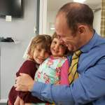 Image shows James Revell, a Doctor of Chiropractic and Clinical Director of Lushington Chiropractic in Eastbourne. with his 2 children.