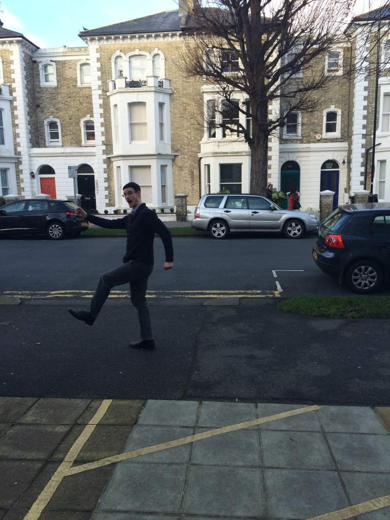 Image shows chiropractor Mykel Mason practising a silly walk to accompany the blog by fellow chiropractor Victoria White about switching old habits for new.