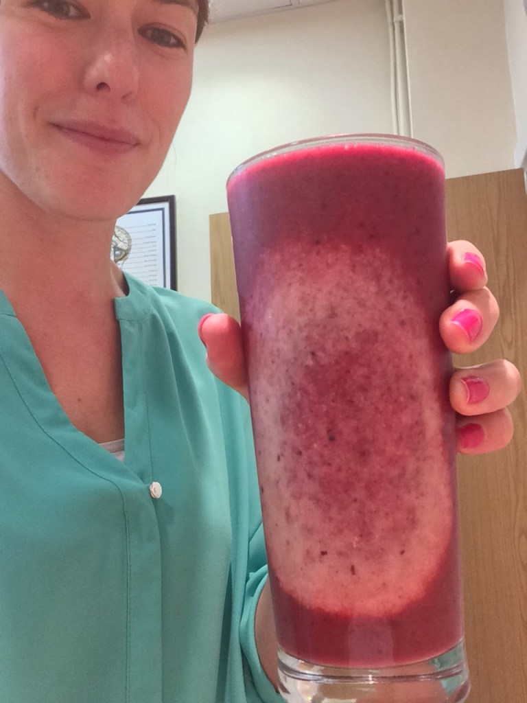 Image shows Lushington's Victoria White holding a glass of homemade fruit smoothie, she made a small change to bring her lunch to work.
