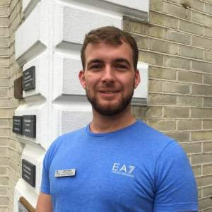 Image shows Sports Therapist Ryan Keats standing outside of Lushington Chiropractic in Eastbourne to accompany his blog on Sciatica.
